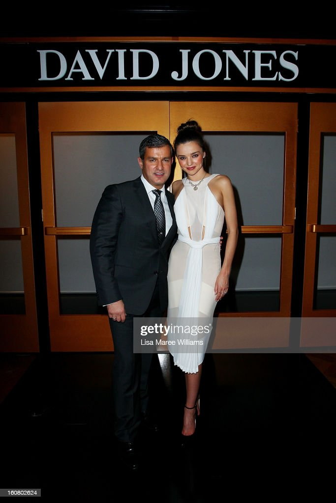 Paul Zahra and <a gi-track='captionPersonalityLinkClicked' href=/galleries/search?phrase=Miranda+Kerr&family=editorial&specificpeople=5714330 ng-click='$event.stopPropagation()'>Miranda Kerr</a> pose during post show drinks at the David Jones A/W 2013 Season Launch at David Jones Castlereagh Street on February 6, 2013 in Sydney, Australia.