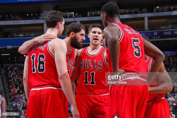 Paul Zipser Nikola Mirotic Doug McDermott and Bobby Portis of the Chicago Bulls huddle up during the game against the Sacramento Kings on February 6...