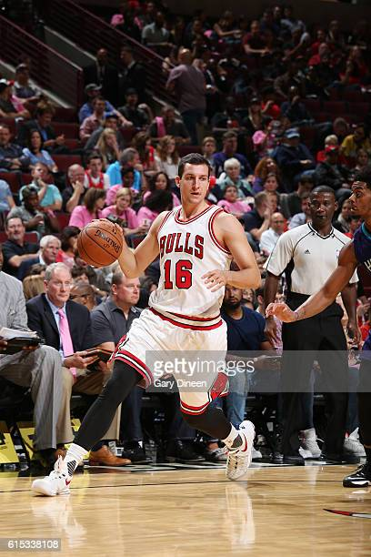 Paul Zipser of the Chicago Bulls drives to the basket against the Charlotte Hornets on October 17 2016 at the United Center in Chicago Illinois NOTE...