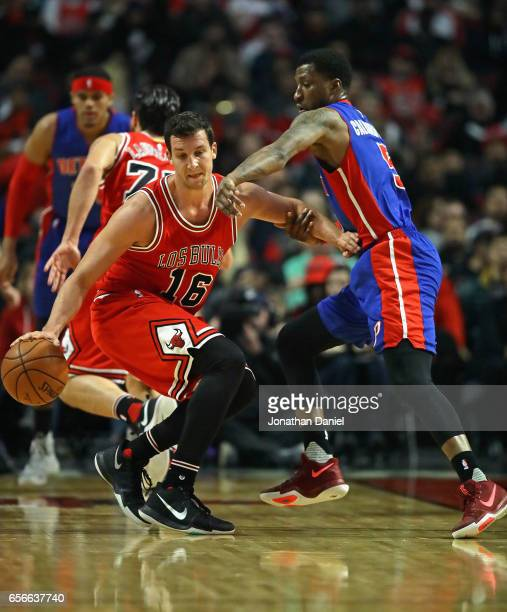 Paul Zipser of the Chicago Bulls is grabbed by Kentavious CaldwellPope of the Detroit Pistons at the United Center on March 22 2017 in Chicago...