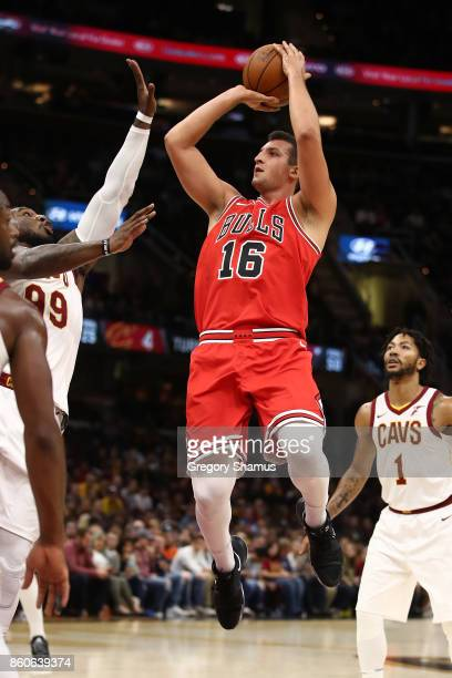 Paul Zipser of the Chicago Bulls takes a first half shot in front of Derrick Rose of the Cleveland Cavaliers during a pre season game at Quicken...