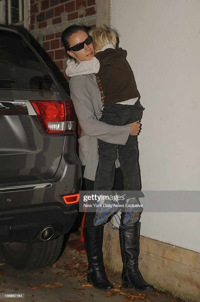 Paula Broadwell carries her son as she returns to her Charlotte, North Carolina home on Sunday, November 18, 2012 following the affair scandal that cost ex-CIA Director David Petreaus his job.