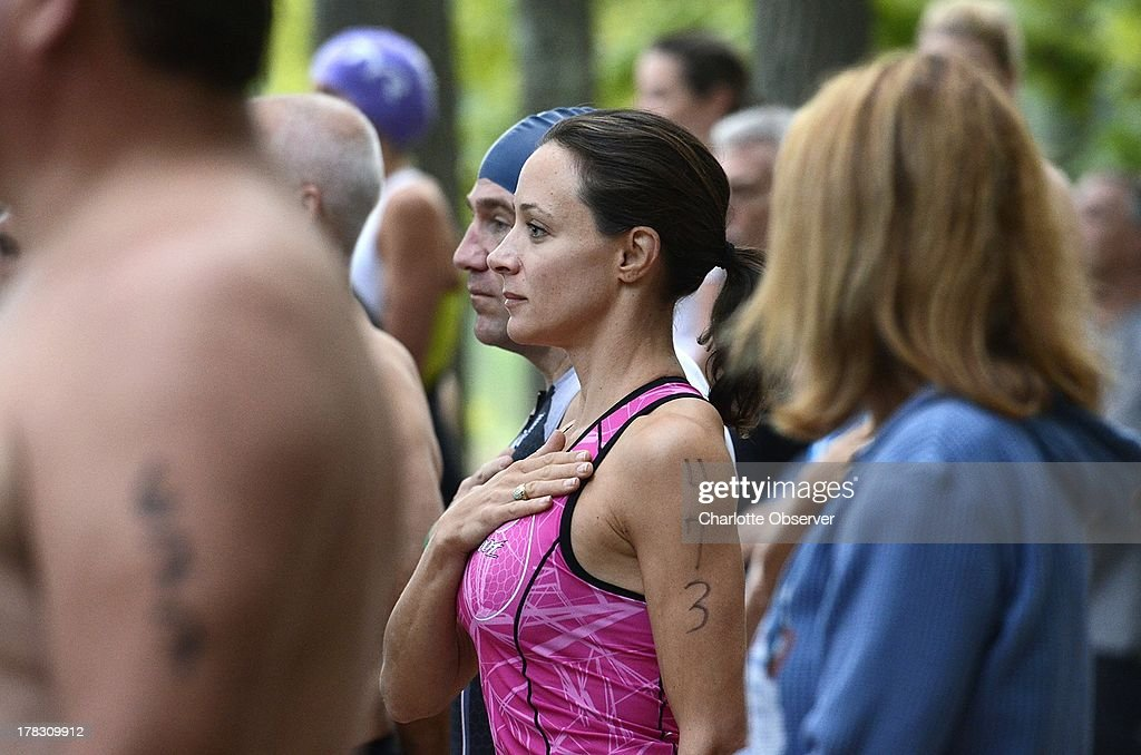<a gi-track='captionPersonalityLinkClicked' href=/galleries/search?phrase=Paula+Broadwell&family=editorial&specificpeople=9969081 ng-click='$event.stopPropagation()'>Paula Broadwell</a>, center, participates in the Lake Norman YMCA Triathlon, August 24, 2013, at Lake Norman. Broadwell's affair with then Gen. David Petraeus brought her a wave of public attention. Since the revelation and investigation whether she was privy to classified national secrets Broadwell has shunned publicity. She is beginning a slow reentry onto the public scene in Charlotte.