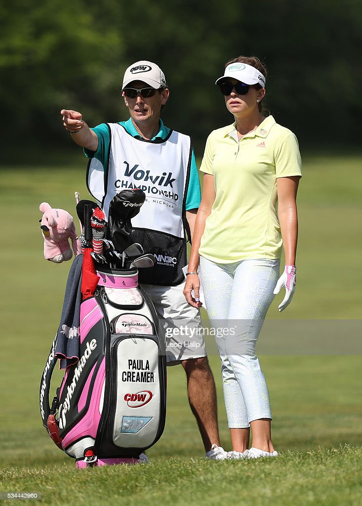 Paula Cramer from the United States talks with her caddie on the eighteenth fareway during the first round of the LPGA Volvik Championships on May 26, 2016 at Travis Pointe Country Club Ann Arbor, Michigan.