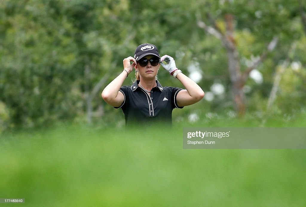 Paula Creamer adjusts her sunglass as she looks down the fairway form the on the 18th tee during the second round of the CN Canadian Women's Open at Royal Mayfair Golf Club on August 23, 2013 in Edmonton, Alberta, Canada.