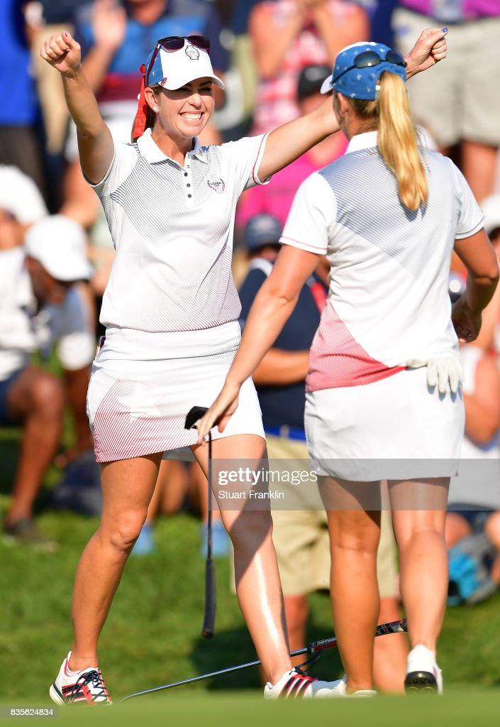 Paula Creamer and Austin Ernst of Team USA celebrates their win during the second day afternoon fourball matches of The Solheim Cup at Des Moines Golf and Country Club on August 19, 2017 in West Des Moines, Iowa.