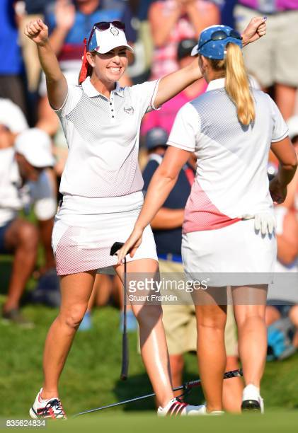 Paula Creamer and Austin Ernst of Team USA celebrates their win during the second day afternoon fourball matches of The Solheim Cup at Des Moines...