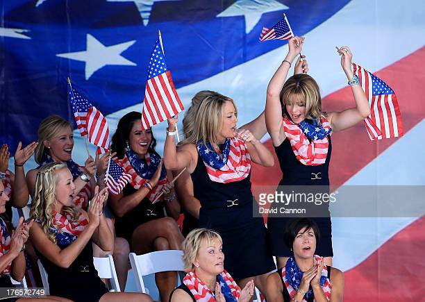 Paula Creamer and Cristie Kerr of the United States Team stand and react to their pairing being announced for the morning foursomes matches at the...
