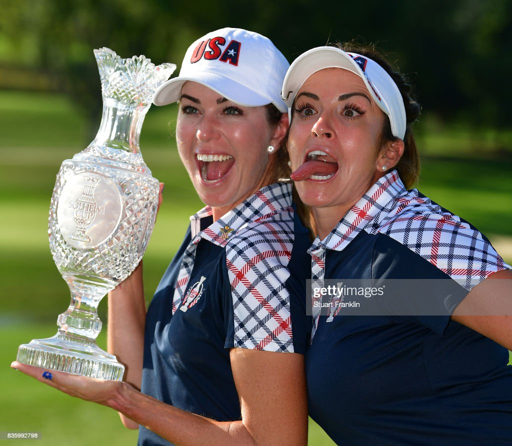 Paula Creamer and Gerina Piller of Team USA hold the Solheim Cup trophy after the final day singles matches of The Solheim Cup at Des Moines Golf and Country Club on August 20, 2017 in West Des Moines, Iowa.