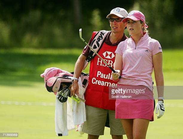 Paula Creamer and her caddy Colin Cann talk on the 15th fairway during the Quarterfinals of the HSBC Women's World Match Play Championship on July 8...