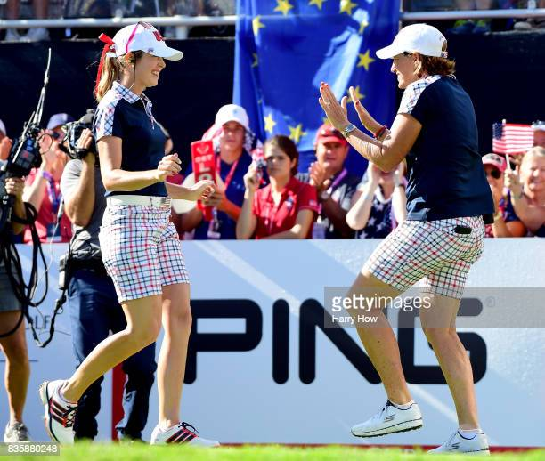 Paula Creamer and Juli Inkster of the United States dance on the first tee during the final day singles matches of the Solheim Cup at the Des Moines...