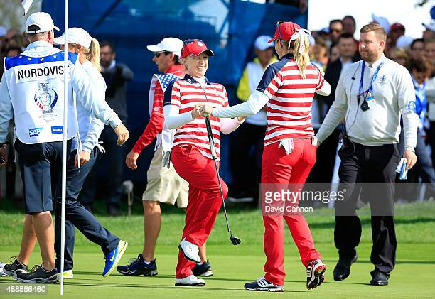 Paula Creamer and Morgan Pressel of the United States embrace after winning their match by 32 agianst Anna Nordqvist and Suzann Pettersen during the...