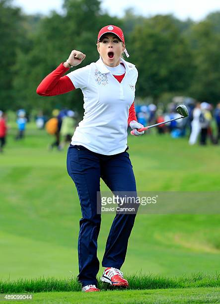 Paula Creamer of the United States reacts as her chip shot on the seventh hole goes close in her match with Morgan Pressel against Charley Hull and...
