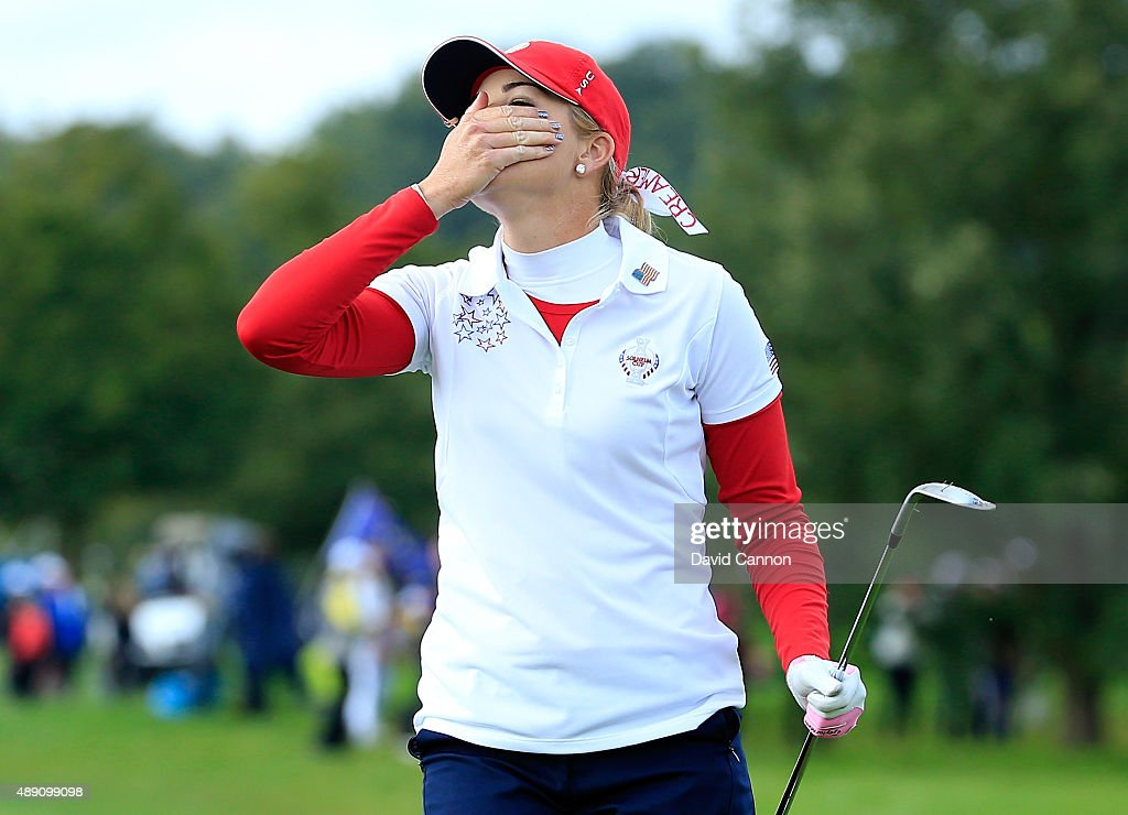 Paula Creamer of the United States reacts as her chip shot on the seventh hole just misses in her match with Morgan Pressel against Charley Hull and...