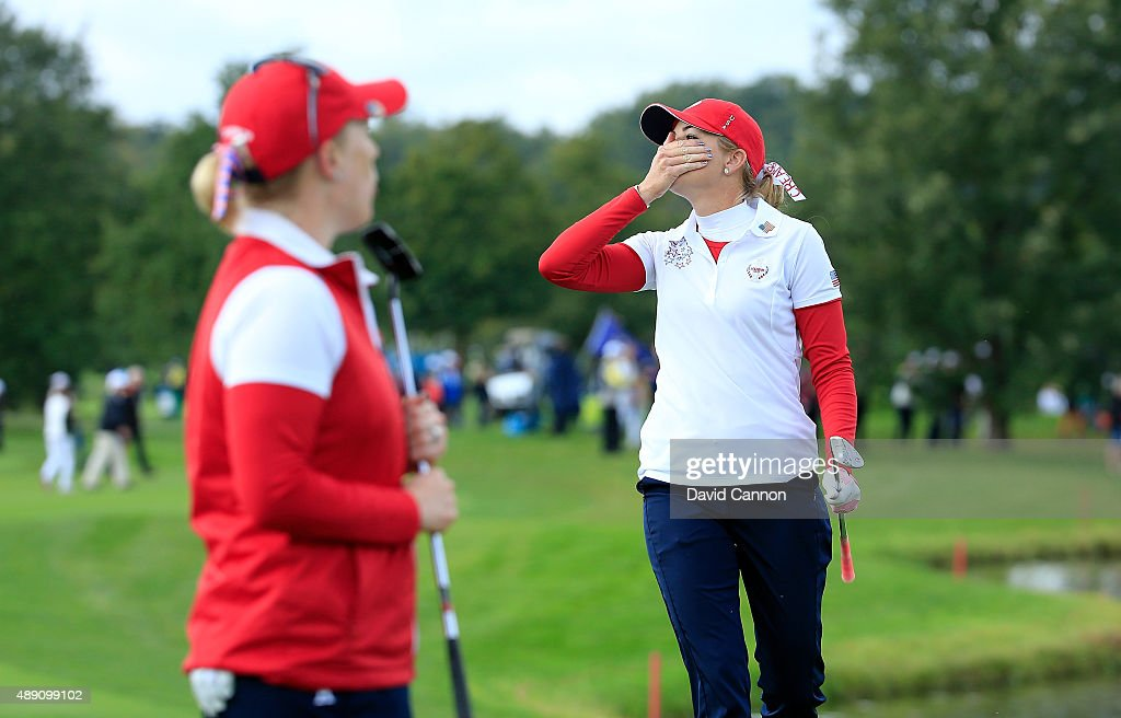 Paula Creamer of the United States reacts as her chip shot on the seventh hole just misses in her match with Morgan Pressel against Charley Hull and Suzann Pettersen of the European Team during the morning foursomes matches in the 2015 Solheim Cup at St Leon-Rot Golf Club on September 19, 2015 in Sankt Leon-Rot, Germany.