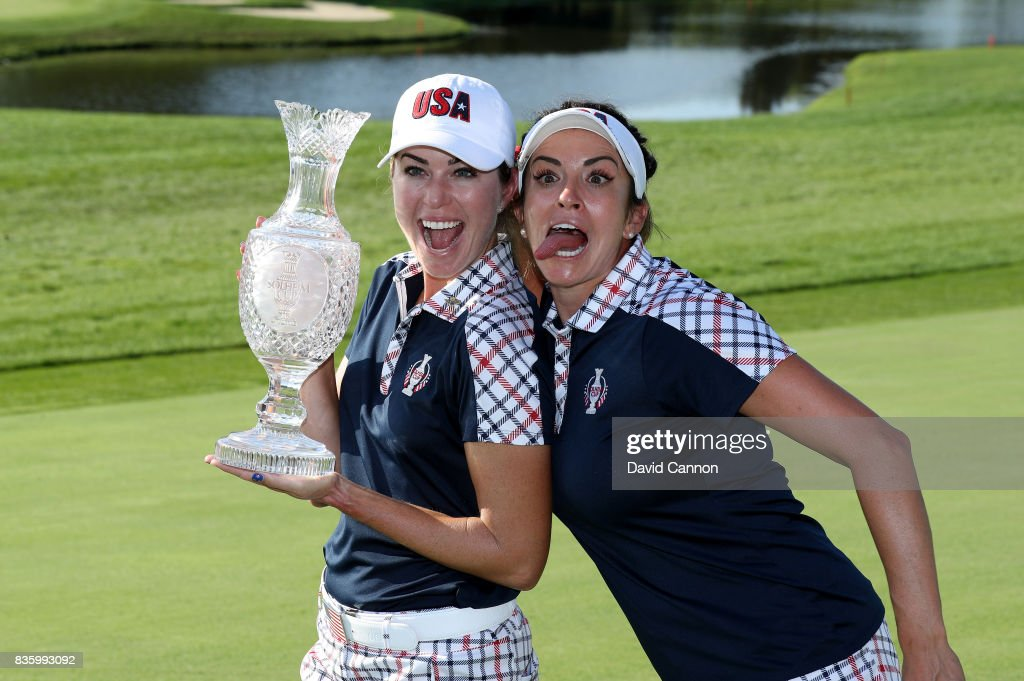 Paula Creamer of the United States Team holds the Solheim Cup as Gerina Piller enjoys a fun moment after the closing ceremony during the final day singles matches in the 2017 Solheim Cup at the Des Moines Golf Country Club on August 20, 2017 in West Des Moines, Iowa.
