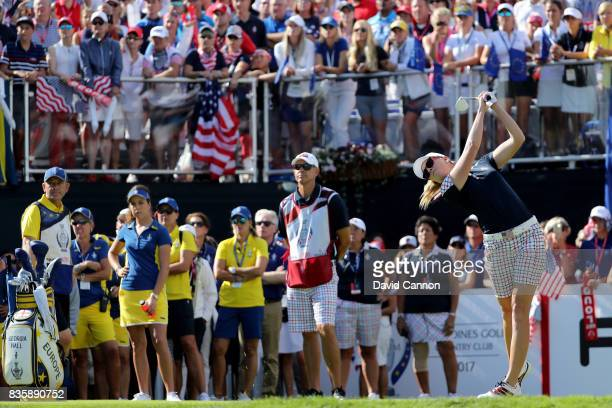 Paula Creamer of the United States team plays her tee shot on the first hole in her match against Georgia Hall of England and the European team...