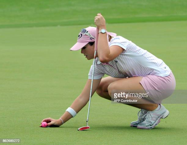 Paula Creamer of the US lines up the ball on the 9th green during the final round of the HSBC Women's Champions golf tournament in Singapore on March...