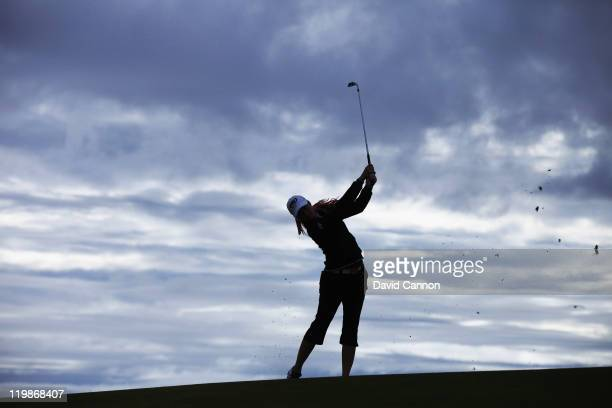 Paula Creamer of the USA plays her second shot on her first hole against the grey morning sky during the proam for the 2011 Ricoh Women's British...