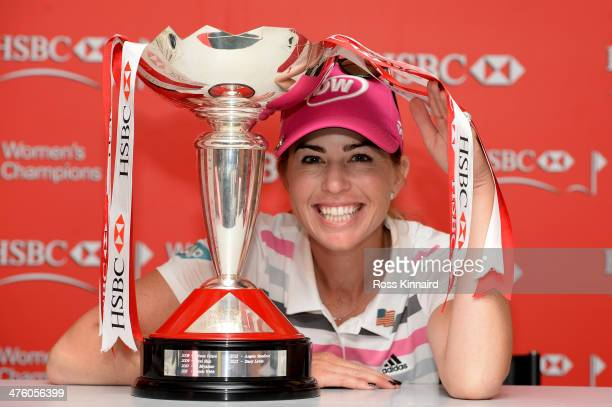 Paula Creamer of the USA poses with the winners trophy after sealing victory in a playoff during the final round of the HSBC Women's Champions at the...