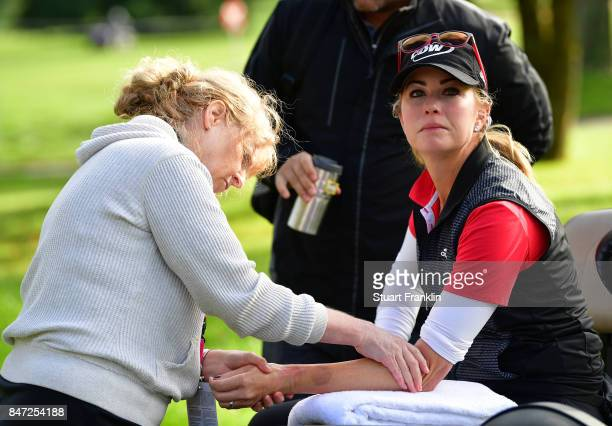 Paula Creamer of USA gets physio treatment for her sprained wrist during the weather delayed first round of The Evina Championship at Evian Resort...