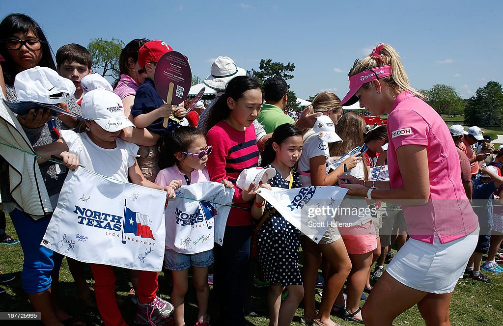 Paula Creamer signs autographs for fans during the final round of the 2013 North Texas LPGA Shootout at the Las Colinas Counrty Club on April 28, 2013 in Irving, Texas.