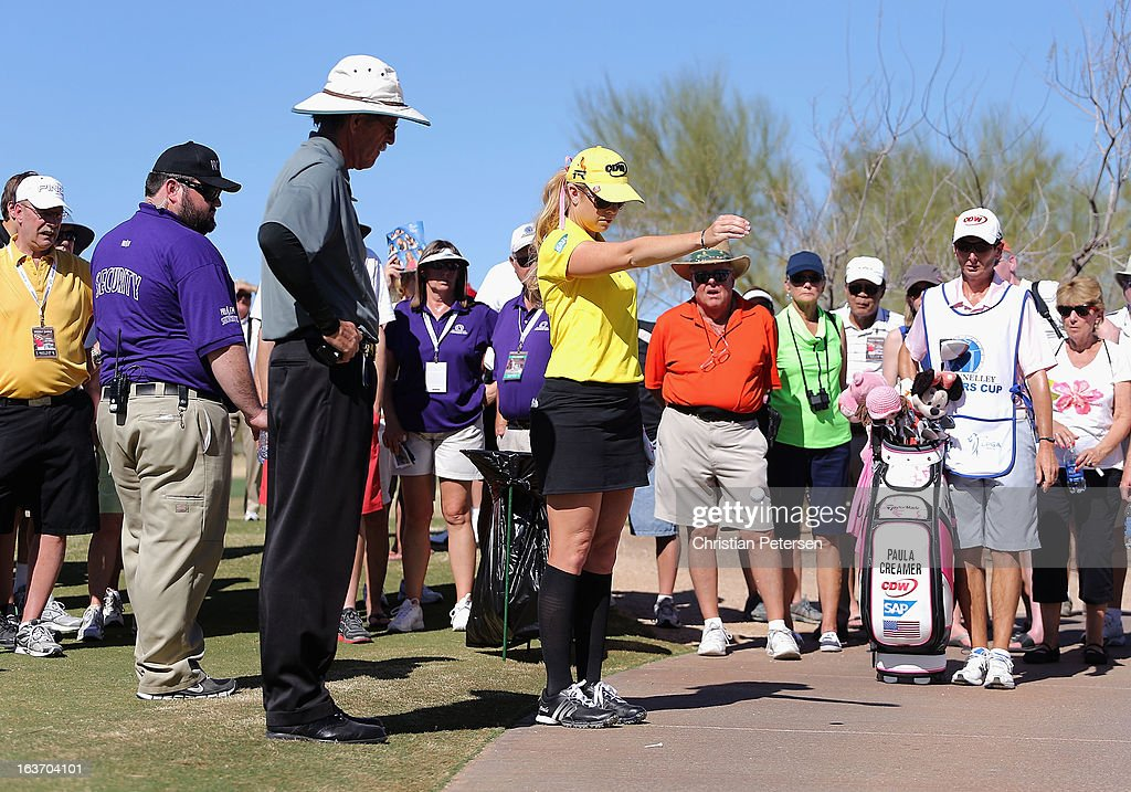<a gi-track='captionPersonalityLinkClicked' href=/galleries/search?phrase=Paula+Creamer&family=editorial&specificpeople=209411 ng-click='$event.stopPropagation()'>Paula Creamer</a> takes a drop after her tee shot went out of bounds on the ninth hole during the first round of the RR Donnelley LPGA Founders Cup at Wildfire Golf Club on March 14, 2013 in Phoenix, Arizona.