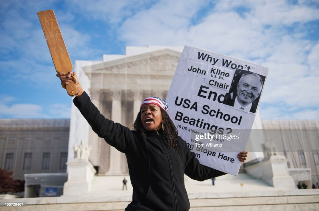 Paula Flowe of New York City, draws attention to a bill in Congress that would outlaw corporal punishment in schools, outside the Supreme Court.