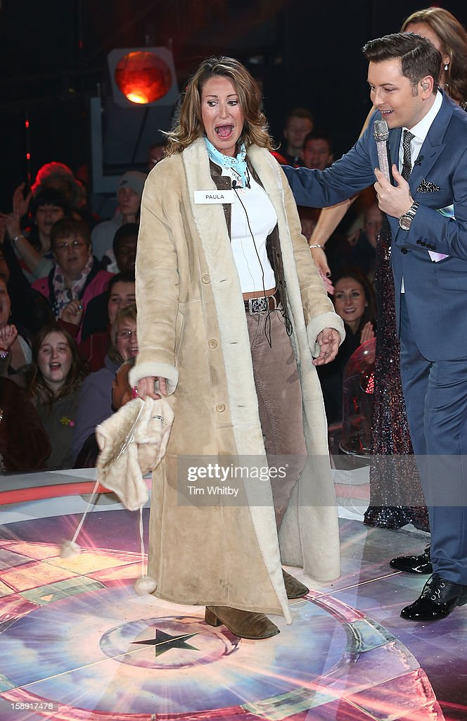 <a gi-track='captionPersonalityLinkClicked' href=/galleries/search?phrase=Paula+Hamilton&family=editorial&specificpeople=753109 ng-click='$event.stopPropagation()'>Paula Hamilton</a> enters the Celebrity Big Brother House at Elstree Studios on January 3, 2013 in Borehamwood, England.
