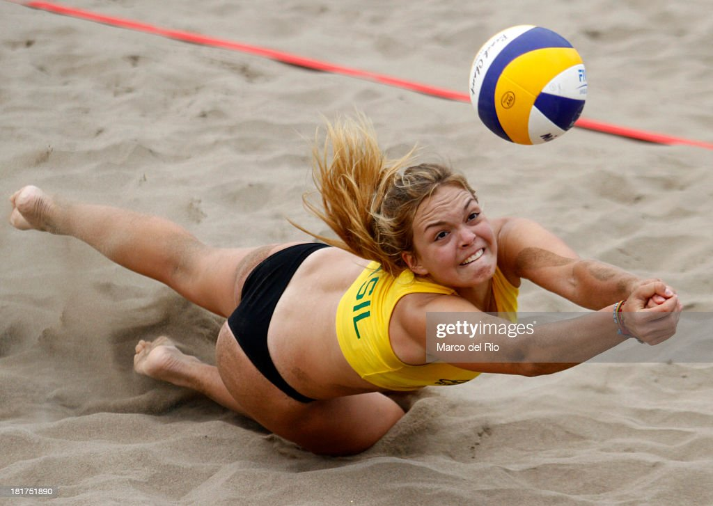 Paula Hoffman of Brasil digs for the ball during the Women's Beach Volleyball Qualification as part of the I ODESUR South American Youth Games at Parque Tematico de los Deportes on September 24, 2013 in Lima, Peru.