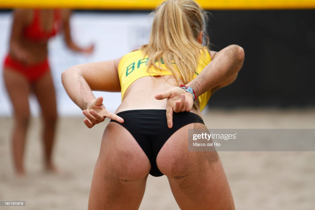 Paula Hoffman of Brazil spikes marks a play during the Woman's Beach Volleyball Qualification as part of the I ODESUR South American Youth Games at Parque Tematico de los Deportes on September 24, 2013 in Lima, Peru.