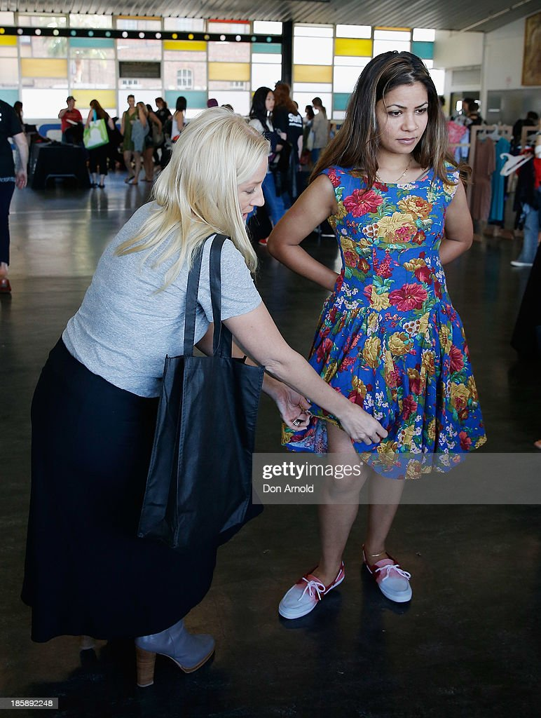 Paula Joye assists customers at the AHM Fashion Exchange at The Overseas Passenger Terminal on October 26, 2013 in Sydney, Australia.