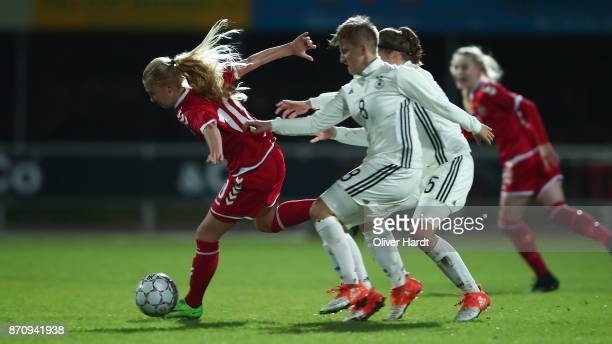 Paula Klensmann of Germany and Sofie Bredgaard of Denmark compete for the ball during the U16 Girls international friendly match betwwen Denmark and...