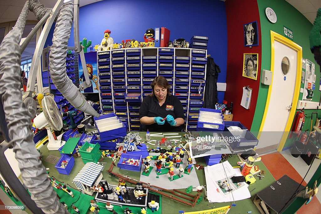 Paula Laughton, a Model Maker, creates LEGO models for a jousting scene in the Model Making Studio at the LEGOLAND Windsor Resort on July 3, 2013 in Windsor, England. LEGOLAND Windsor Resort, which has been open since 1996, has 55 interactive rides and attractions and thousands of LEGO models made from around 80 million individual bricks. LEGOLAND Windsor employs 4 Model Makers who design, build and maintain all of the LEGO models on site.