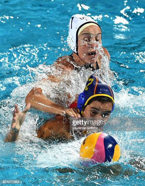 Paula Leiton Arrones of Spain is challenged by Makenzie Fischer of United States during the Women's Water Polo gold medal match between the United...