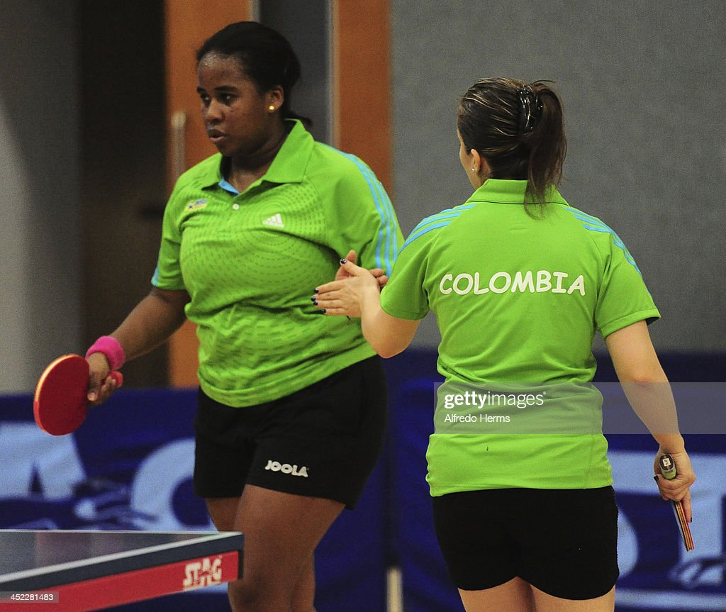 Paula Medina and Leidy Ruano of Colombia celebrate during the women's double table tenis final match as part of the XVII Bolivarian Games Trujillo 2013 at Club Regatas on November 27, 2013 in Lima, Peru.