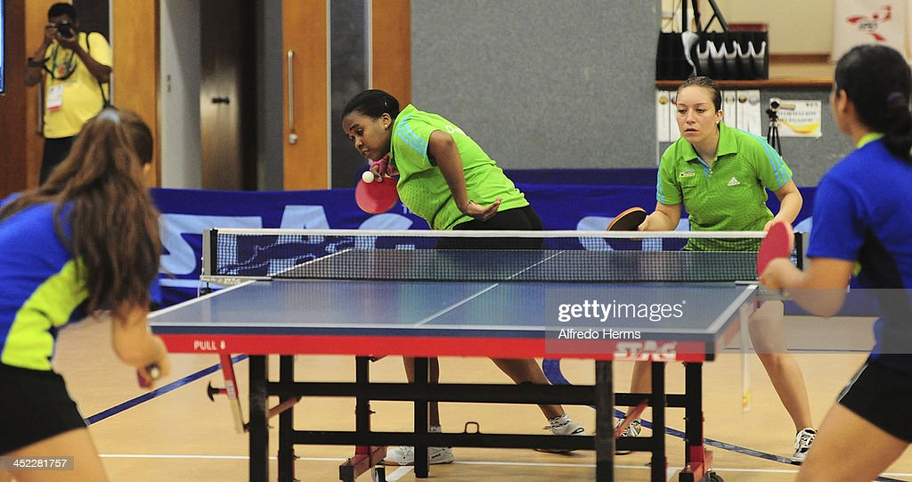 Paula Medina and Leidy Ruano of Colombia compete against Gemlis Arvelo and Roxy Gonzalez of Venezuela in women's double table tenis final match as part of the XVII Bolivarian Games Trujillo 2013 at Club Regatas on November 27, 2013 in Lima, Peru.