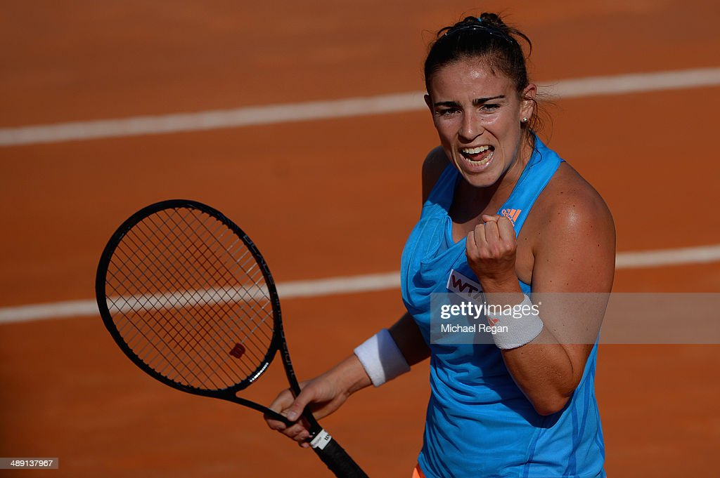 <a gi-track='captionPersonalityLinkClicked' href=/galleries/search?phrase=Paula+Ormaechea&family=editorial&specificpeople=8801820 ng-click='$event.stopPropagation()'>Paula Ormaechea</a> of Argentina celebrates a point against Anastasia Grymalska of Italy during qualifying for the Internazionali BNL d'Italia 2014 on May 10, 2014 in Rome, Italy.