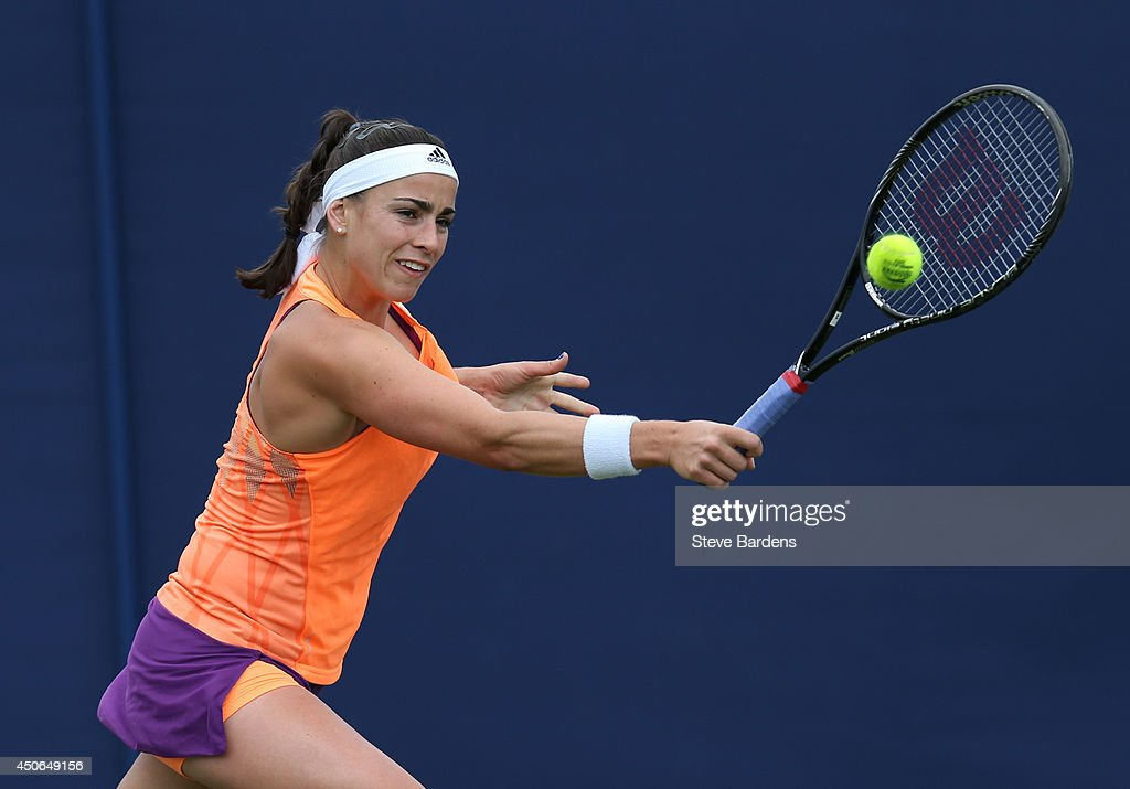 Paula Ormaechea of Argentina plays a backhand against Ajla Tomljanovic of Croatia during their third round qualification match on day two of the Aegon International at Devonshire Park on June 15, 2014 in Eastbourne, England.
