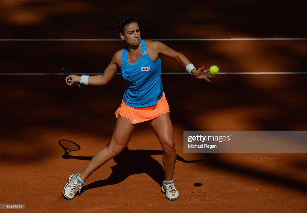 <a gi-track='captionPersonalityLinkClicked' href=/galleries/search?phrase=Paula+Ormaechea&family=editorial&specificpeople=8801820 ng-click='$event.stopPropagation()'>Paula Ormaechea</a> of Argentina plays a shot against Anastasia Grymalska of Italy during qualifying for the Internazionali BNL d'Italia 2014 on May 10, 2014 in Rome, Italy.