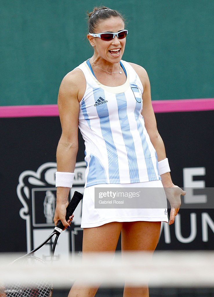 <a gi-track='captionPersonalityLinkClicked' href=/galleries/search?phrase=Paula+Ormaechea&family=editorial&specificpeople=8801820 ng-click='$event.stopPropagation()'>Paula Ormaechea</a> of Argentina reacts during a tennis match between Argentina and Japan as part of the Fed Cup 2014 at Pilara Tennis Club on February 09, 2014 in Pilar, Argentina.