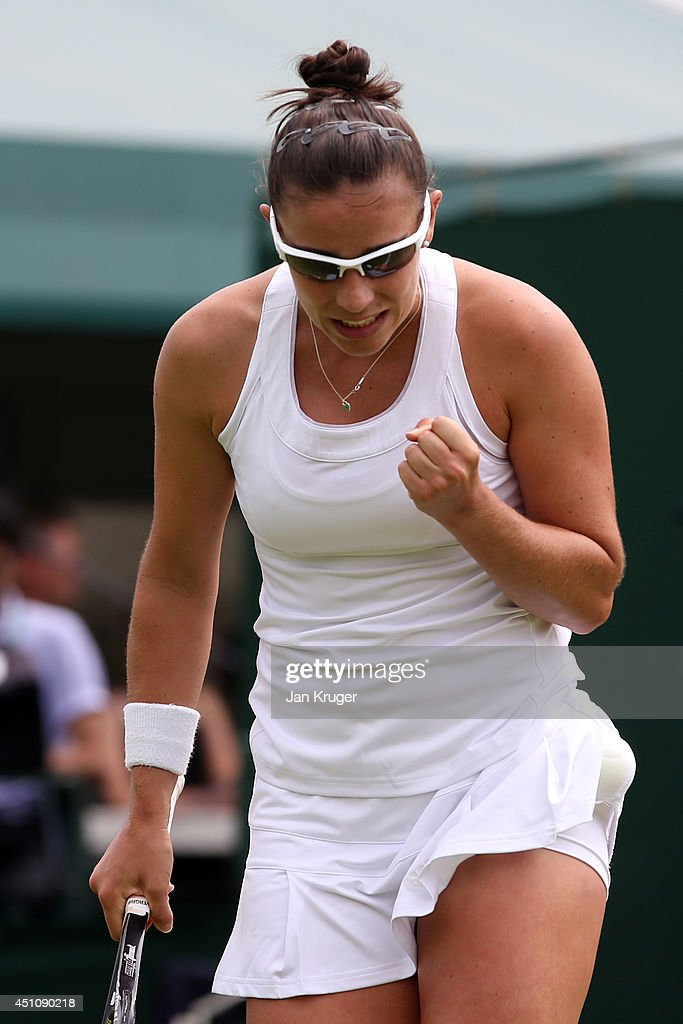 <a gi-track='captionPersonalityLinkClicked' href=/galleries/search?phrase=Paula+Ormaechea&family=editorial&specificpeople=8801820 ng-click='$event.stopPropagation()'>Paula Ormaechea</a> of Argentina reacts during her Ladies' Singles first round match against Polona Hercog of Slovenia on day one of the Wimbledon Lawn Tennis Championships at the All England Lawn Tennis and Croquet Club at Wimbledon on June 23, 2014 in London, England.