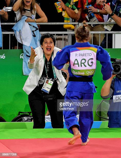 Paula Pareto of Argentina is greeted by her ecstatic coach after defeating BoKyeong Jeong of South Korea for the u48kg gold medal during day 1 of the...