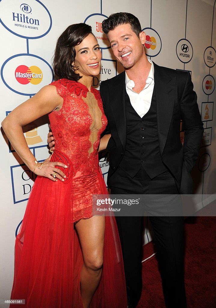 <a gi-track='captionPersonalityLinkClicked' href=/galleries/search?phrase=Paula+Patton&family=editorial&specificpeople=752812 ng-click='$event.stopPropagation()'>Paula Patton</a> and <a gi-track='captionPersonalityLinkClicked' href=/galleries/search?phrase=Robin+Thicke&family=editorial&specificpeople=724390 ng-click='$event.stopPropagation()'>Robin Thicke</a> attend the 56th annual GRAMMY Awards Pre-GRAMMY Gala and Salute to Industry Icons honoring Lucian Grainge at The Beverly Hilton on January 25, 2014 in Los Angeles, California.