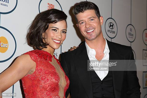 Paula Patton and singer Robin Thicke arrive at the 2014 HYUNDAI / GRAMMYs Clive Davis PreGRAMMY Gala Activation Equus Fleet Arrivals at The Beverly...