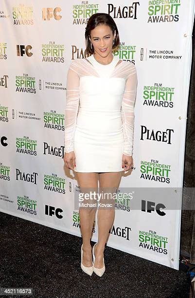 Paula Patton wearing Piaget multicolored stone earrings poses onstage during Piaget at 2014 Spirit Awards nominations press conference at W Hollywood...
