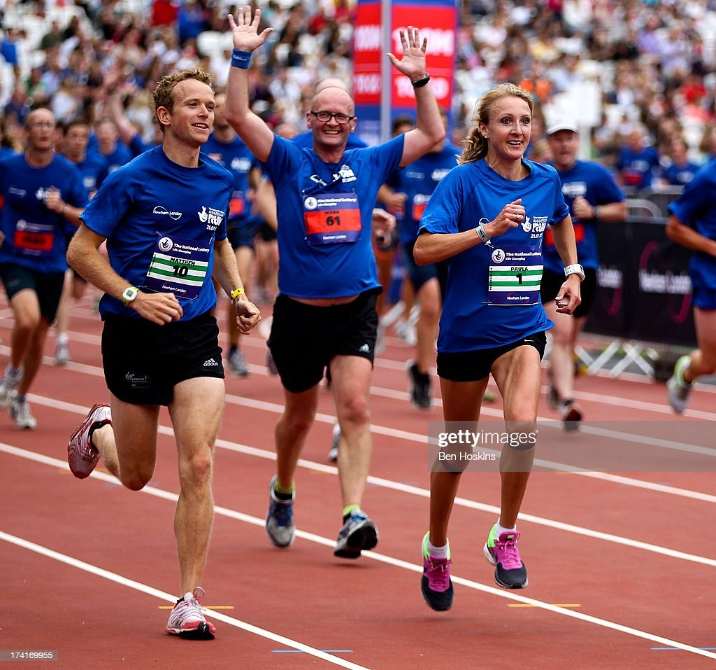 <a gi-track='captionPersonalityLinkClicked' href=/galleries/search?phrase=Paula+Radcliffe&family=editorial&specificpeople=202257 ng-click='$event.stopPropagation()'>Paula Radcliffe</a> (R) makes her way round the course during The National Lottery Anniversary Run at The Queen Elizabeth Olympic Park on July 21, 2013 in Stratford, England.