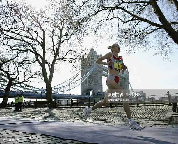 Paula Radcliffe of England runs along the cobbles past the Tower of London during the 2003 Flora London Marathon on April 13 2003 at the Mall in...