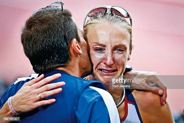 Paula Radcliffe of Great Britain cries on the shoulder of her husband Gary Lough after she could only finish 23rd in the Olympic women's marathon on...