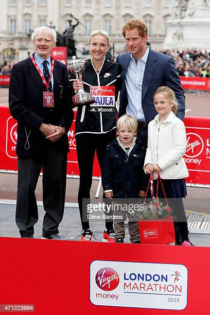 Paula Radcliffe of Great Britain poses with John Disley Prince Harry and her children after receiving the inaugural John Disley London Marathon...